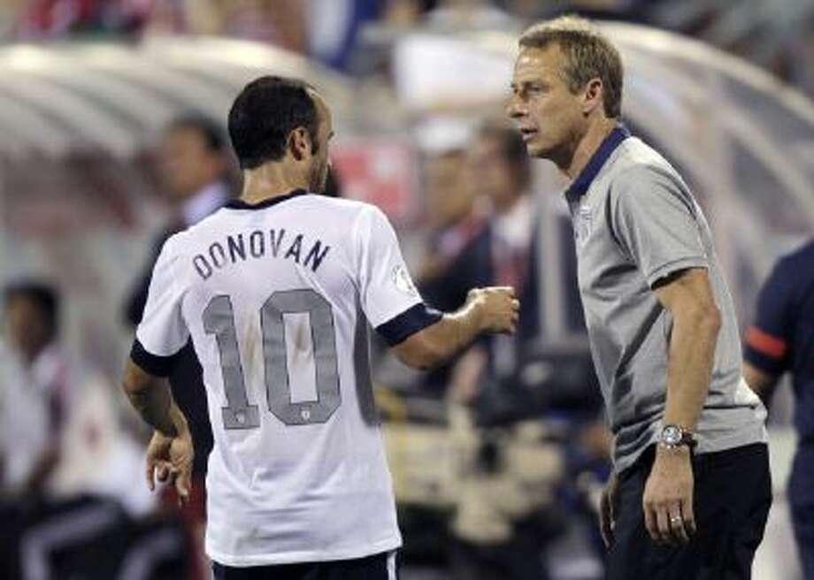 Landon Donovan talks with U.S. Soccer coach Jurgen Klinsmann during a match Sept. 10, 2013.