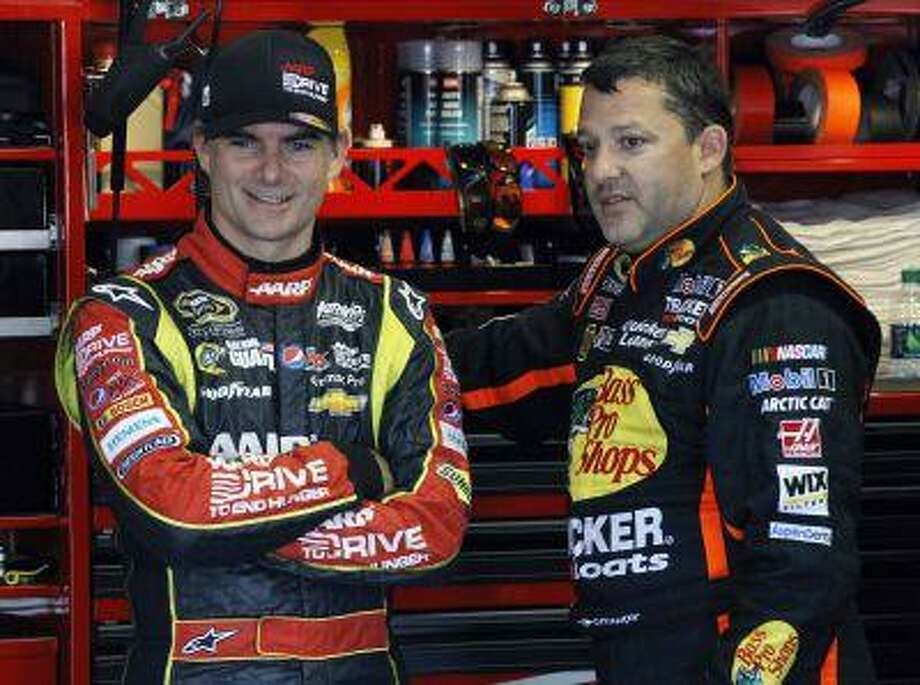 Drivers Jeff Gordon, left, and Tony Stewart talk in the garage during practice for Sunday's NASCAR Sprint Cup Series auto race, Friday Aug. 2, 2013, in Long Pond, Pa. Photo: ASSOCIATED PRESS / AP2013