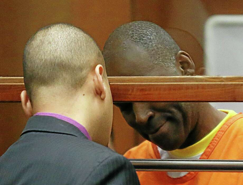 """Actor Michael Jace, right, talks with his attorney Jason Sias in Los Angeles Superior Court during a hearing of the charge that he murdered his wife, Friday, Aug. 1, 2014. Jace waived his right to a preliminary hearing, which means the case will proceed to trial without an initial presentation of evidence to a judge. Jace played a police officer on """"The Shield"""" TV series, appeared in the show """"Southland"""" and had small roles in such movies as """"Boogie Nights"""" and """"Forrest Gump."""" (AP Photo/Frederick Brown, Pool) Photo: AP / Getty Images"""