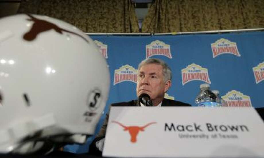 Texas coach Mack Brown listens to a question during a Valero Alamo Bowl NCAA college football news conference, Thursday, Dec. 12, 2013, in San Antonio. Texas.
