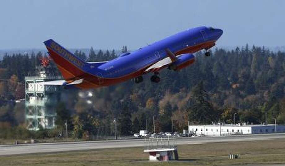 A Southwest Airlines plane takes off Monday, Oct. 28, 2013, from Seattle-Tacoma International Airport in Seattle.