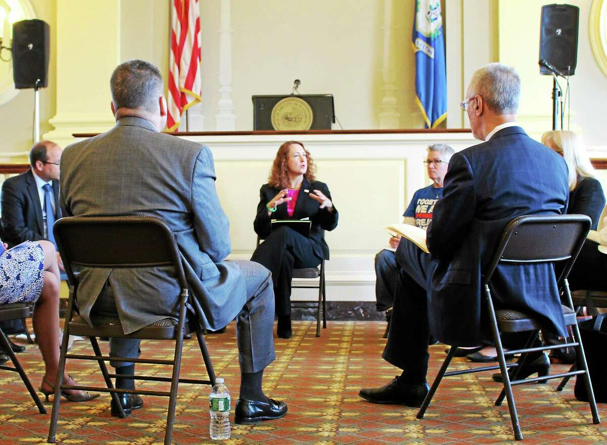 U.S. Rep. Elizabeth Esty addresses mental health, medical and law enforcement professionals from around the state in Waterbury City Hall in April during a discussion on the state's rising heroin problem.