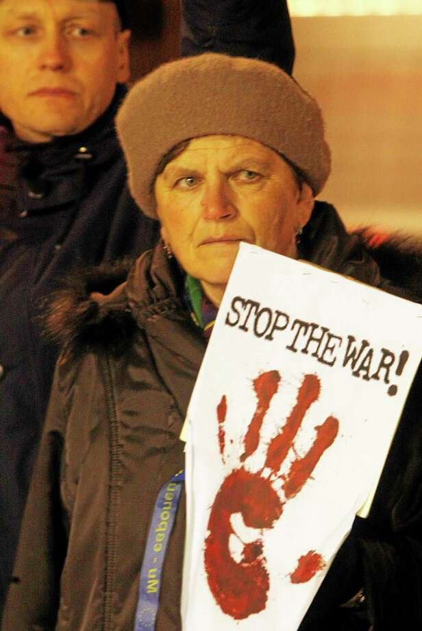 Warsaw residents stage a picket before the U.S. Embassy in Warsaw, Poland, Thursday, March 6, 2014, to demand sanctions against Russian leader Vladimir Putin and his government for the military incursion in Ukraineís Crimea region. (AP Photo/Czarek Sokolowski) Photo: AP / AP