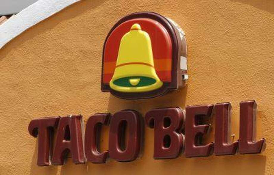 A Taco Bell restaurant is seen in Richmond, Va. Taco Bell restaurants will soon stop serving kids' meals as the company shifts its efforts to sales to Millenials. (Associated Press/Steve Helber) Photo: AP / AP