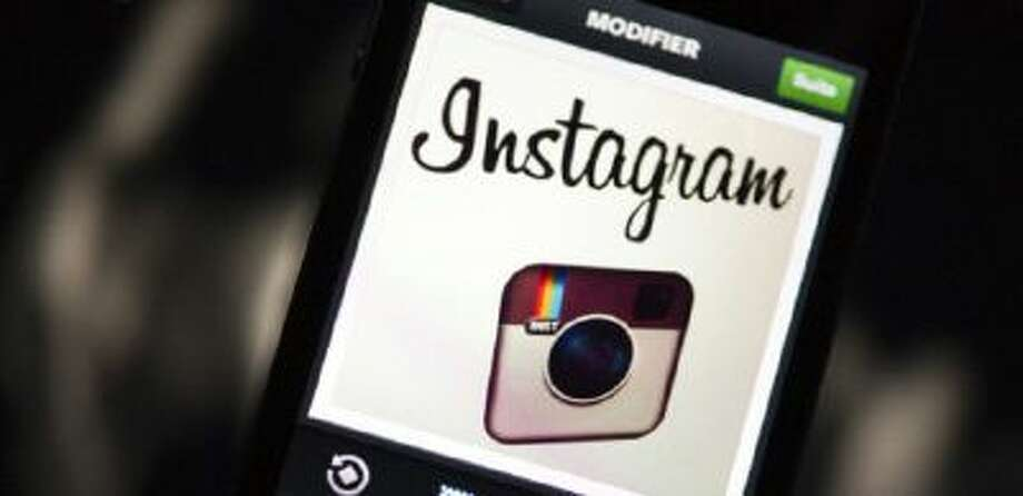 The Instagram logo is displayed on a smartphone.