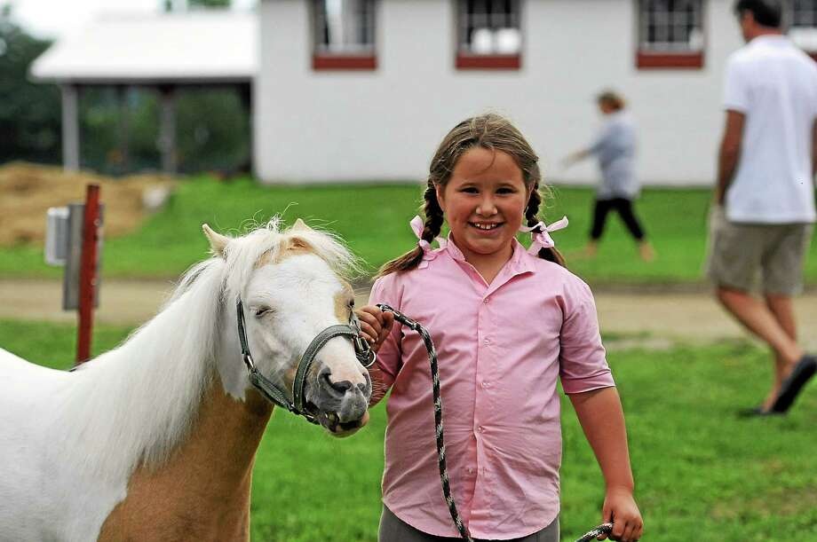 Makenzie Maynard, 8, of Washington Depot, with her miniature horse, Fancy. Fancy is 7 years old. Makenzie's group with 4-H is the Laurel Riders. Photo: Laurie Gaboardi — The Register Citizen
