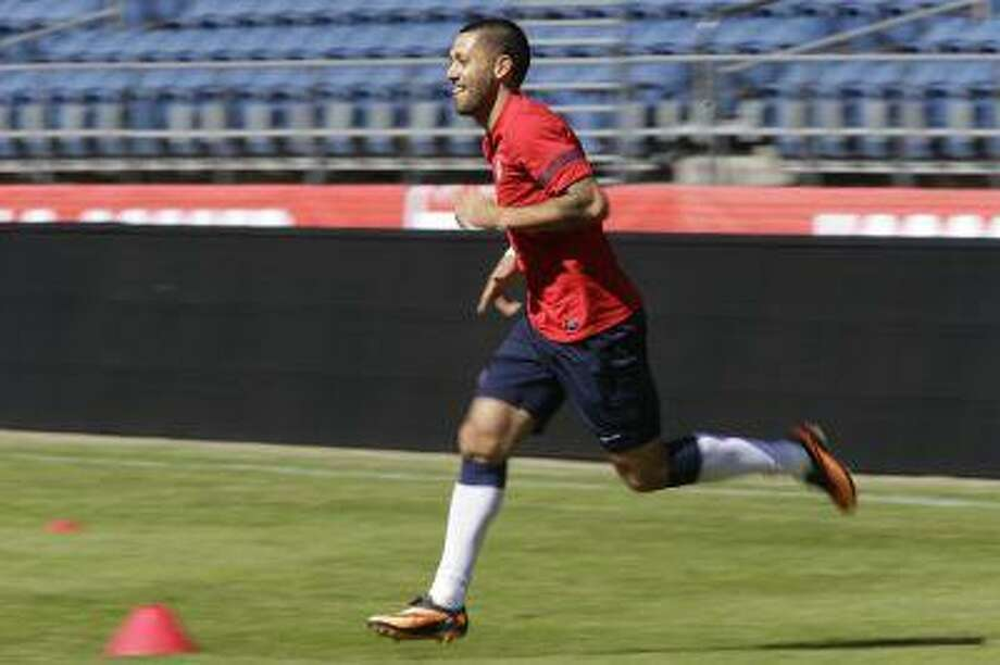 U.S. national soccer team captain Clint Dempsey runs Monday, June 10, 2013, during a practice drill in Seattle. The U.S. will face Panama on Tuesday, June 11, 2013, for a World Cup qualifier soccer match. Photo: AP / AP