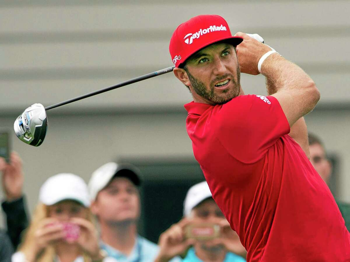 Dustin Johnson tees off during the pro-am event at the Canadian Open on July 23 at Royal Montreal Golf Club.