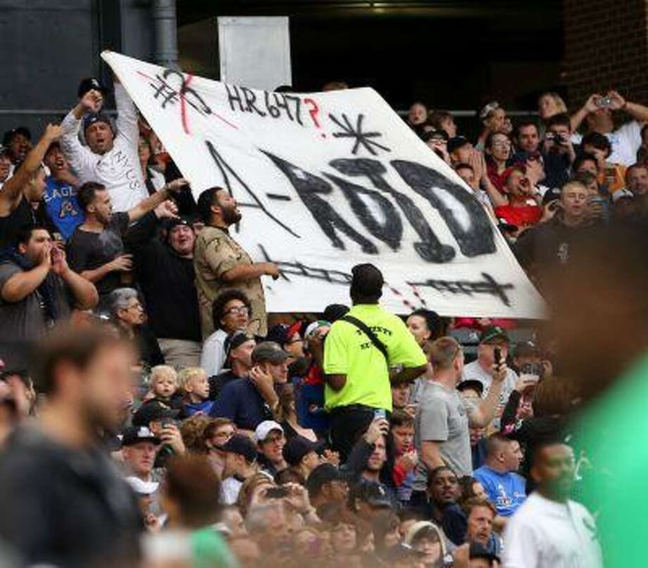 Chicago White Sox fans hold up a sign as Alex Rodriguez bats for the first time in a baseball game at US Cellular Field in Chicago on Monday, Aug.,5, 2013. Photo: ASSOCIATED PRESS / AP2013