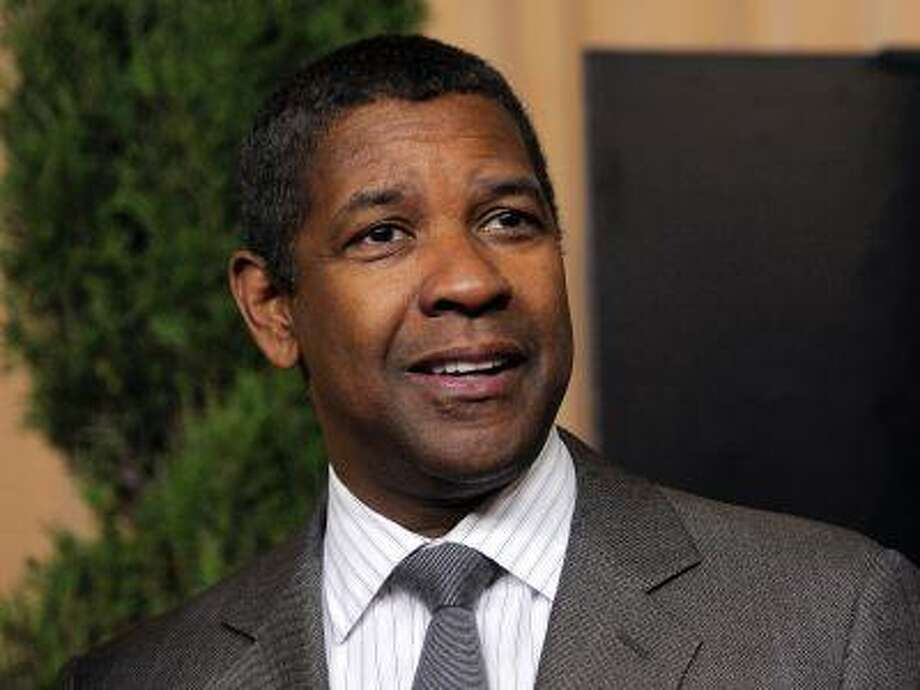 """In this Feb. 4, 2013 photo, actor Denzel Washington, nominated for best actor in a leading role for """"Flight,"""" arrives at the 85th Academy Awards Nominees Luncheon in Beverly Hills, Calif. Washington will narrate a PBS documentary about the 1963 March on Washington for civil rights. (Chris Pizzello/Invision/AP, File) Photo: Chris Pizzello/Invision/AP / Invision"""
