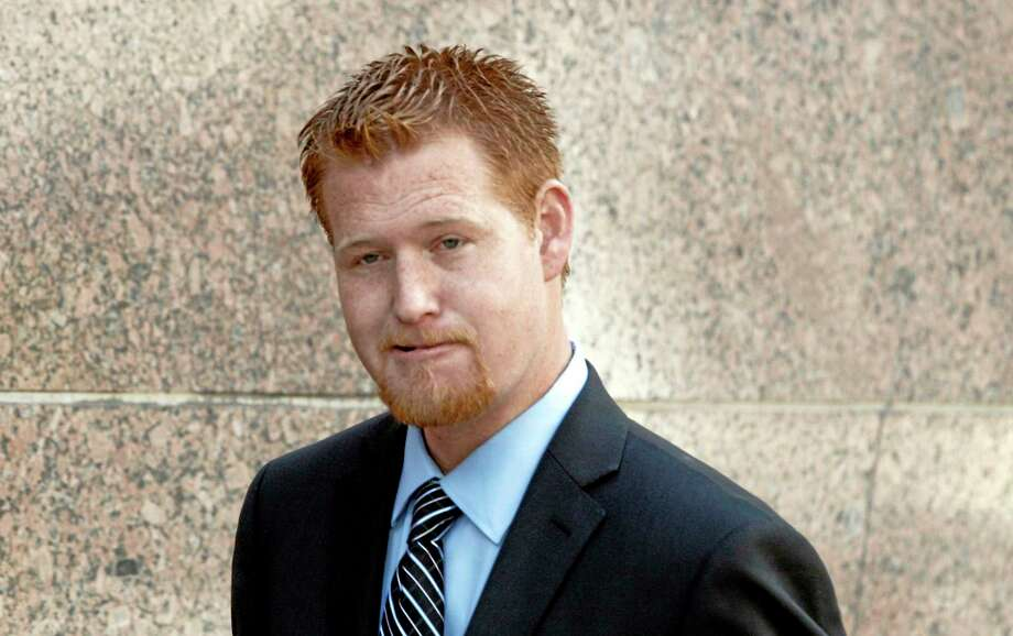Redmond O'Neal arrives at court Thursday Dec. 12, 2013, to testify in the case of an Andy Warhol portrait of Farrah Fawcett in Los Angeles. Attorneys for Ryan OíNeal concluded their case in the actorís bid to keep a version of the portrait of Fawcett on Thursday. The former coupleís son Redmond, was among the final witnesses. The University of Texas at Austin is suing Ryan O'Neal to try to gain possession of the portrait. Fawcett left all her artwork to the school and it claims O'Neal improperly took it from her condo days after her death.  (AP Photo/Nick Ut) Photo: AP / AP