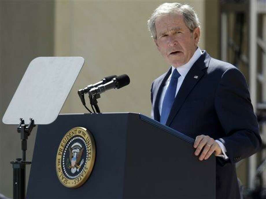 File - In this April 25, 2013 file photo, former President George W. Bush speaks during the dedication of the George W. Bush Presidential Center in Dallas. Bush has successfully undergone a heart procedure after doctors discovered a blockage in an artery. Bush spokesman Freddy Ford says a stent was inserted during a procedure Tuesday, Aug 6, 2013 at Texas Health Presbyterian Hospital in Dallas. (AP Photo/Tony Gutierrez, Pool, File) Photo: AP / AP POOL