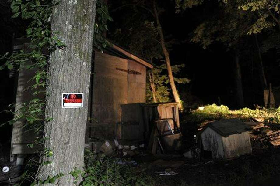 "A ""No Trespassing"" sign hangs on a tree by the dilapidated home of alleged gunman 59-year-old Rockne Newell, Tuesday, Aug. 6, 2013 in Saylorsburg, Pa. Police said Newell entered the Ross Township Municipal Building Monday evening and shot several people. (AP Photo/Chris Post) Photo: AP / FR170581 AP"