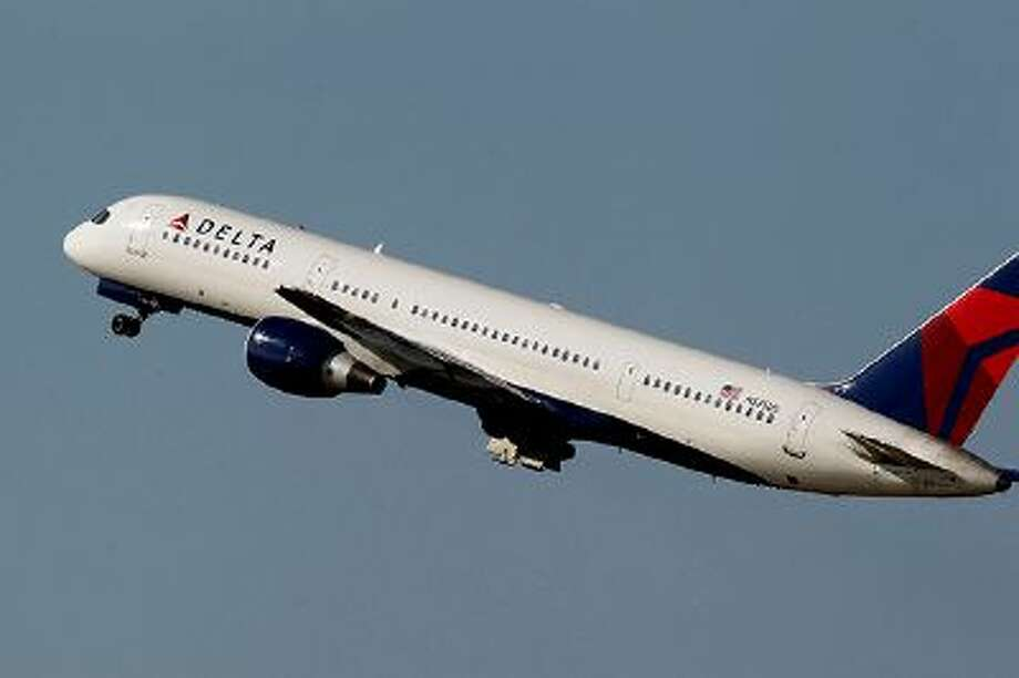 File-This photo taken Jan. 20, 2011, shows a Delta Airlines Boeing 757 taking off  in Tampa, Fla.  Delta Air Lines is making fundamental changes to its frequent flier program and will reward those who buy its priciest tickets, as opposed to those who fly the most miles. The airline said Wednesday, Feb. 26, 2014,  that the 2015 SkyMiles program will better recognize frequent business travelers and leisure customers who buy premium fares. (AP Photo/Chris O'Meara, File) Photo: AP / A2011
