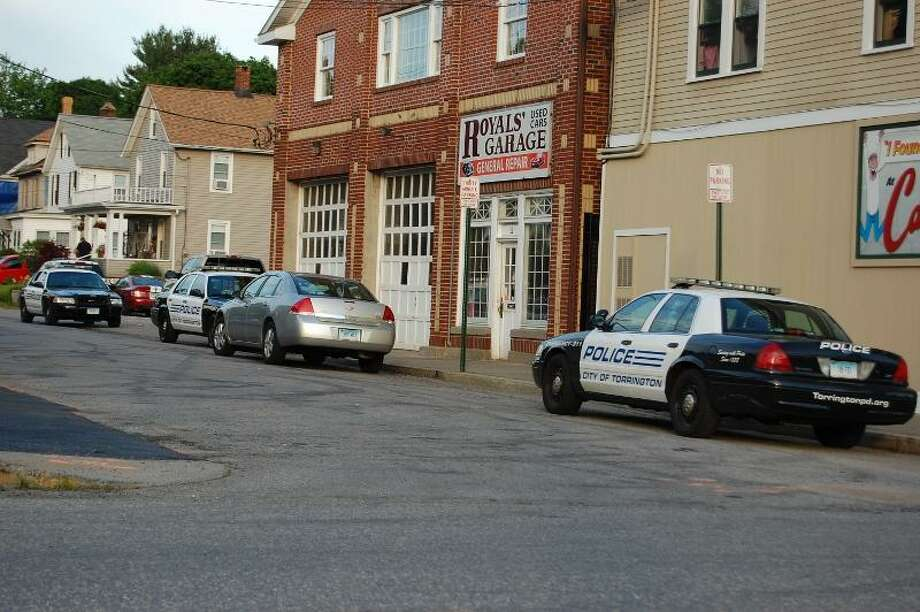 Tom Caprood/Register Citizen - Police cars seen along Calhoun Street Wednesday night, next to the Smoker's Club shop at 644 Main St. in Torrington, which was robbed at knifepoint, according to police.