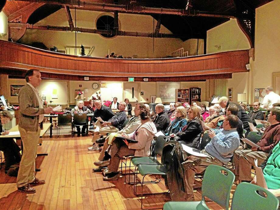 Reg Smith moderated the town meeting where the $367,643 school security project was passed unanimously by approximately 50 New Hartford residents. Photo: Kate Hartman — Register Citizen