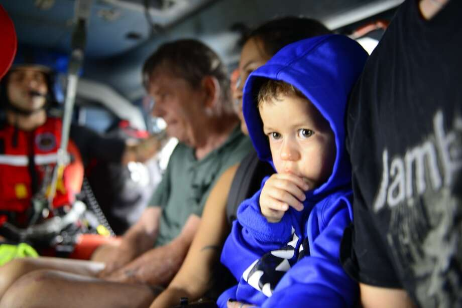 Photos: Dramatic rescues around HoustonCoast Guard Air Station Houston responds to search and rescue requests after Hurricane Harvey in Houston, Texas, Aug. 27, 2017.See more images of rescue operations in the Houston area. Photo: U.S. Coast Guard Photo By Petty Officer 3rd Class Johanna Strickland.