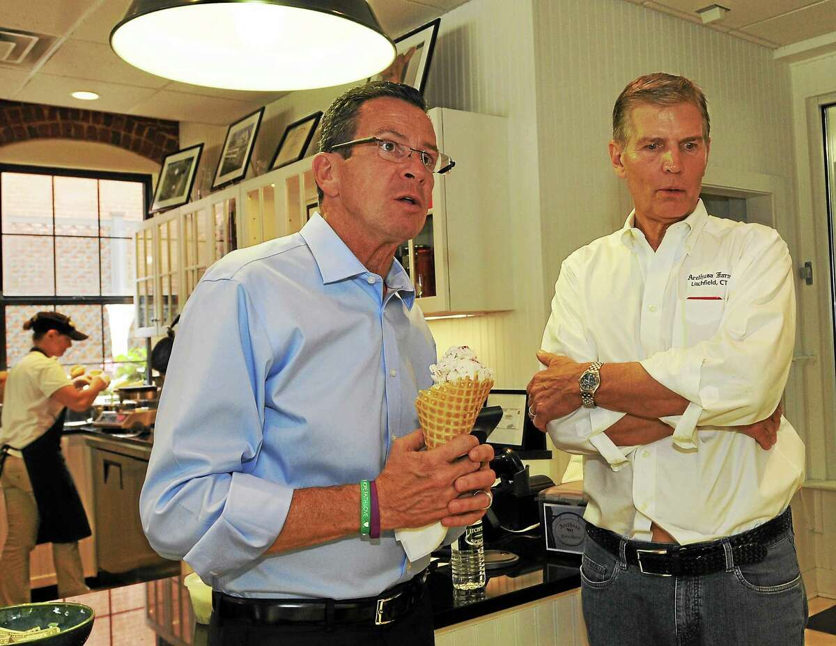 Gov. Dannel Malloy with Arethusa Farm co-owner Anthony Yurgaitis in the creamery shop in Litchfield Friday. The governor made three stops in Litchfield County to highlight popular tourism destinations the region has to offer.