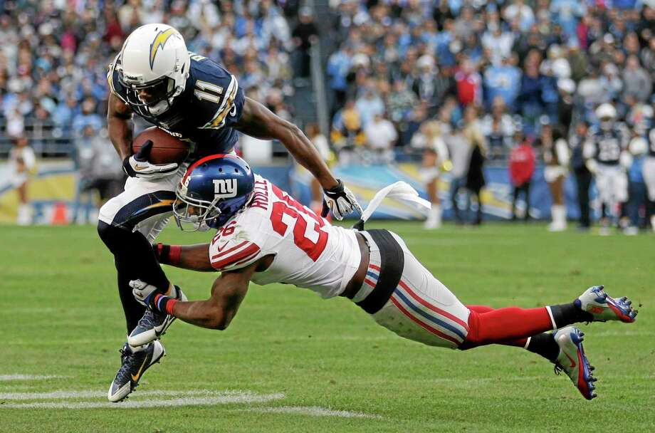 The Chargers' Eddie Royal runs by New York Giants safety Antrel Rolle during Sunday's game in San Diego. Photo: Gregory Bull — The Associated Press  / AP