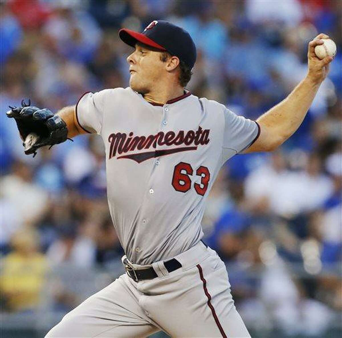 Minnesota Twins starting pitcher Andrew Albers delivers to a Kansas City Royals batter during the third inning of a baseball game at Kauffman Stadium in Kansas City, Mo., Tuesday, Aug. 6, 2013. (AP Photo/Orlin Wagner)