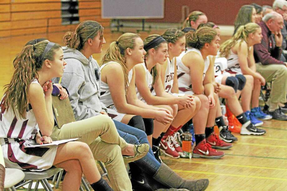 The Torrington Red Raiders sit on the bench during their game against Sacred Heart. Photo: Marianne Killackey - Special To Register Citizen  / 2013