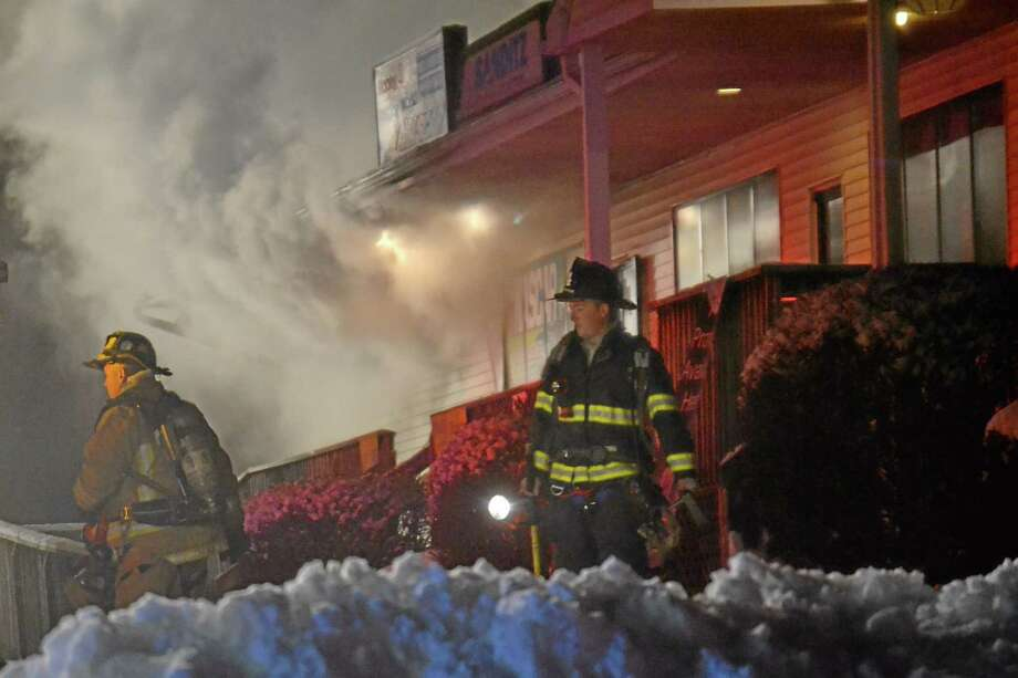 Firefighters battled a three-alarm blaze at the Hobby and Trophy World store in the Carlís True Value Complex on North Elm Street in Torrington early Wednesday morning, Dec. 11, 2013. Photo: Tom Cleary—Register Citizen