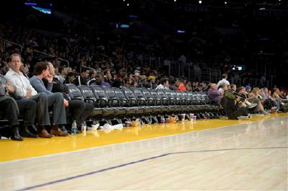 Several empty seats are seen with two minutes left in the Los Angeles Lakers' NBA basketball game against the Detroit Pistons, Sunday, Nov. 4, 2012, in Los Angeles. The Lakers won 108-79. (AP Photo/Mark J. Terrill) Photo: AP / AP