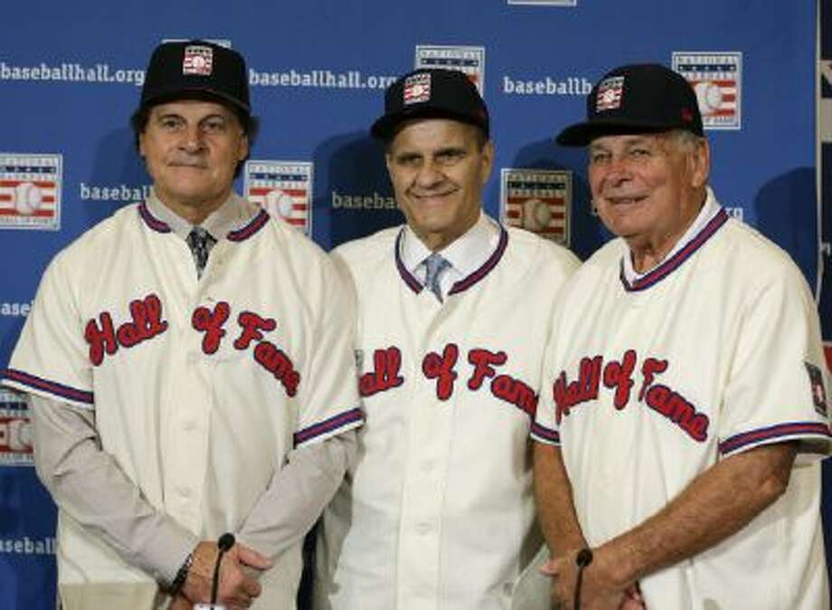 Torre, La Russa and Cox will be celebrating their Hall of Fame induction this fall. How many of their players took steroids, do you think?