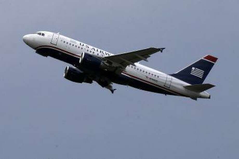 This is a US Airways jet taking off from Pittsburgh International Airport on July 23. Photo: AP / AP