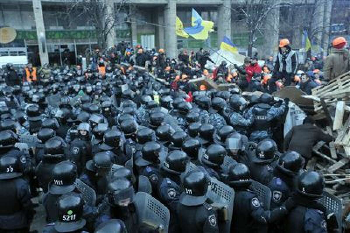 Protesters and police clash in Kiev, Ukraine, on Wednesday, Dec. 11.