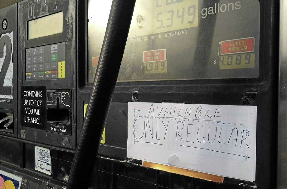 "A hand-written sign reading ""Available Regular Only"" covers up two gasoline grade buttons at Sheerazi Mini Mart Wednesday in Torrington. The state's Department of Consumer Protection investigated a report about contaminated gas at the gas station and found the owners took the right steps to warn patrons of the contamination. Photo: Esteban L. Hernandez—Register Citizen"