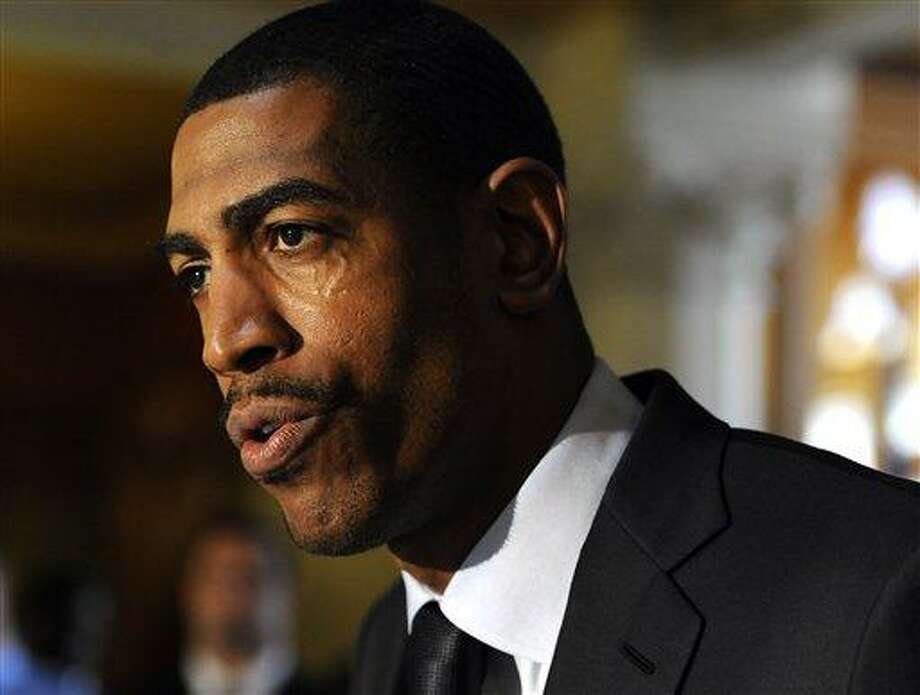 Connecticut head coach Kevin Ollie speaks at Husky Day at the Capitol in Hartford, Conn., Wednesday, April 24, 2013. (AP Photo/Jessica Hill) Photo: AP / FR125654 AP