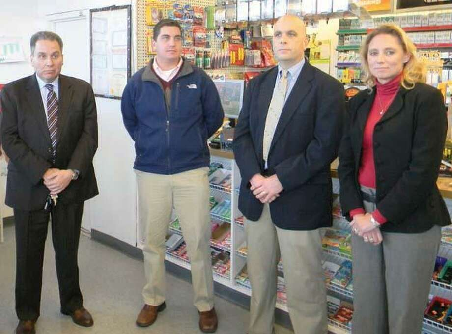 Torrington Police Chief Michael Maniago, left, stands with Mayor Ryan Bingham, Lt. Mike Emanuel and state Rep. Michelle Cook, D-65 during a press conference on Thursday. The conference was held at the Sunoco gas station and USA Food mart at 882 East Main St. where management removed the substance known as K2 from shelves. MIKE AGOGLIATI/ Register Citizen File photo