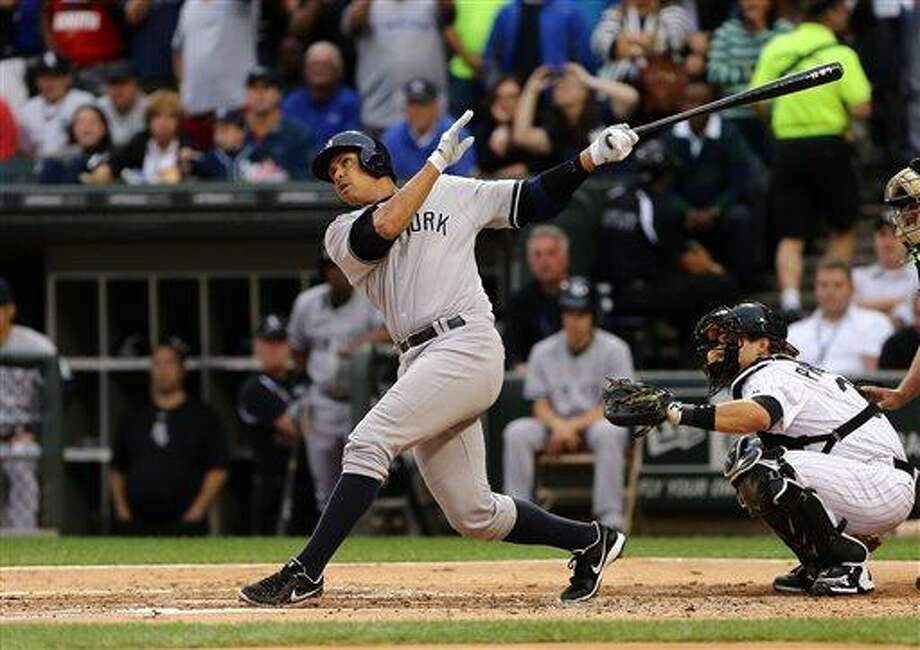 New York Yankees' Ale Rodriguez gets a hit in his first at bat against the Chicago White Sox in the first inning in a baseball game at US Cellular Field in Chicago on Monday, Aug., 5, 2013. (AP Photo/Charles Cherney) Photo: AP / FR170067 AP