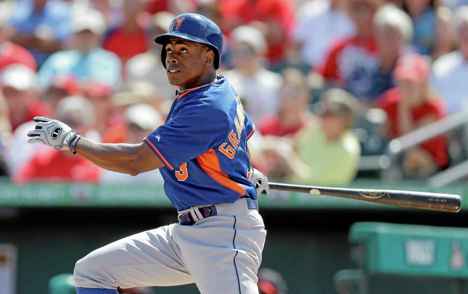 Outfielder Curtis Granderson was the New York Mets' big free agent acquisition in the offseason. Players' union head Tony Clark is paying attention to the team's payroll, which is over $100 million less than the other team in New York. Photo: Jeff Roberson — The Associated Press  / AP
