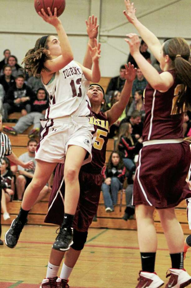 Torrington's Brie Pergola goes for a layup in the Red Raiders 42-40 loss to Sheehan. Pergola led all Red Raiders with 12 points. Photo: Marianne Killackey — Special To The Register Citizen  / 2013