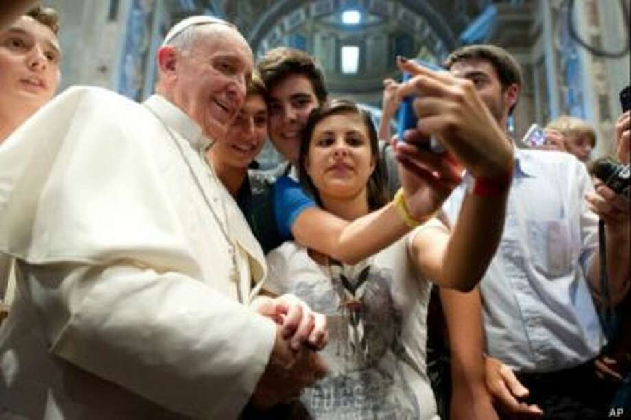 Pope Francis takes a selfie. Francis was named the 2013 Person of the Year by Time.