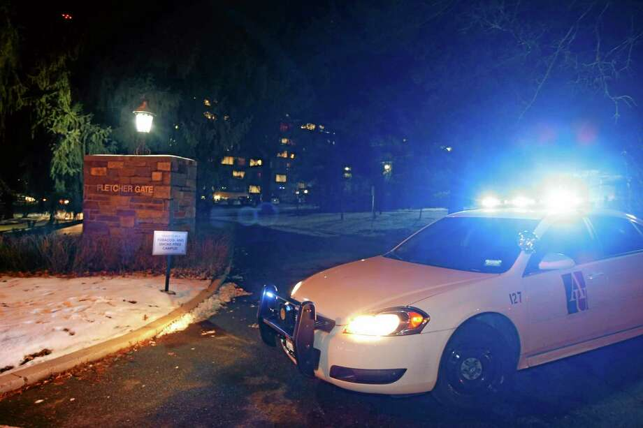 An American University police car blocks the entrance to American University at the Fletcher Gate on Wednesday night, Dec. 11, 2013, in Washington. Police and school officials say American University's campus in the nation's capital is on lockdown after police received calls about a man with a gun. (AP Photo/Alex Brandon) Photo: AP / AP