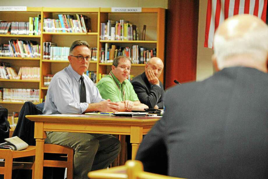 Paul Cavagnero, left, hears the conclusion of an investigation into his actions during a school improvement committee meeting, Sept. 11. D. Charles Stohler from Carmody & Torrance in Waterbury presents the investigation's findings. Photo: Journal Register Co.