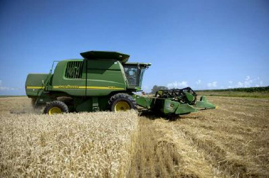 Soft red winter wheat is harvested in a field in Kirkland, Ill., in July.