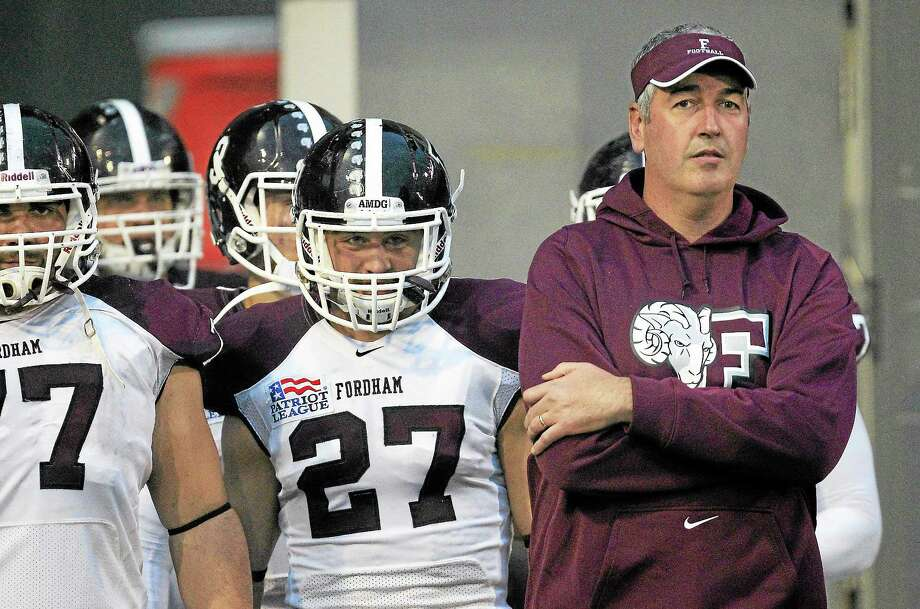 Fordham signed head coach Joe Moorhead, right, to a contract extension on Tuesday. The former UConn offensive coordinator had been mentioned as a possible candidate to take over the Huskies. Photo: Al Behrman - The Associated Press  / AP