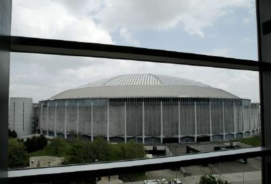 The Astrodome, as seen from a March 25, 2011 file photo. At left is one of the ramps, which was imploded Sunday night.