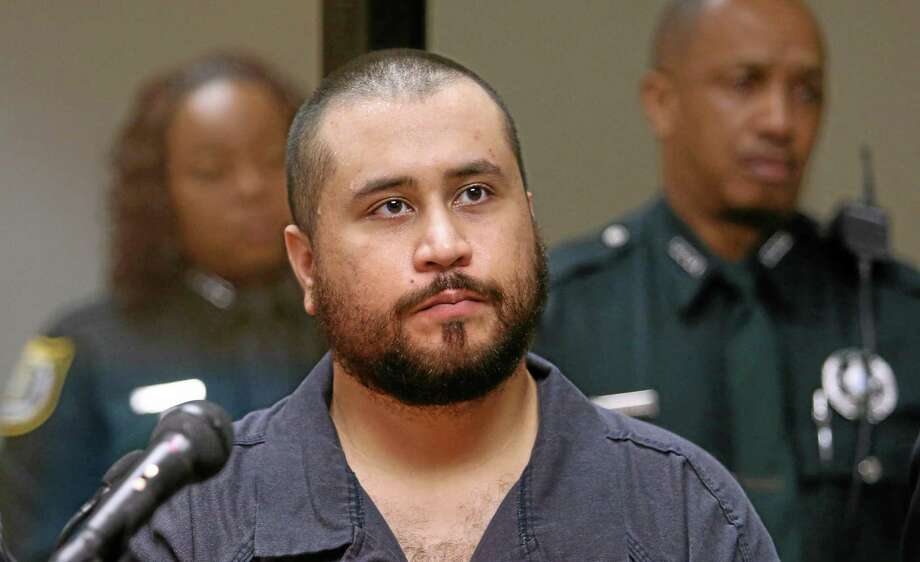 FILE - In this Tuesday, Nov. 19,  2013, file photo, George Zimmerman, acquitted in the high-profile killing of unarmed black teenager Trayvon Martin, listens in court, in Sanford, Fla., during his hearing on charges including aggravated assault stemming from a fight with his girlfriend. Zimmerman is asking a judge to change the terms of his bond so he can have contact with his girlfriend. Zimmerman on Monday, Dec. 9, 2013, filed an affidavit from his girlfriend that says she doesnít want him charged with aggravated assault, battery and criminal mischief. (AP Photo/Orlando Sentinel, Joe Burbank, Pool, File) Photo: AP / Pool Orlando Sentinel
