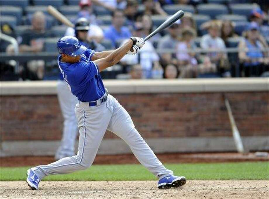Kansas City Royals pinch Hitter Justin Maxwell hits a home run during the 12th inning of an interleague baseball game against the New York Mets Saturday, Aug. 3, 2013 at Citi Field in New York. (AP Photo/Bill Kostroun) Photo: AP / FR51951 AP