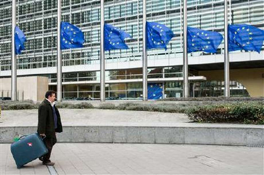 European Union flags fly at the European Commission headquarters in Brussels, Belgium. Photo: AP / AP