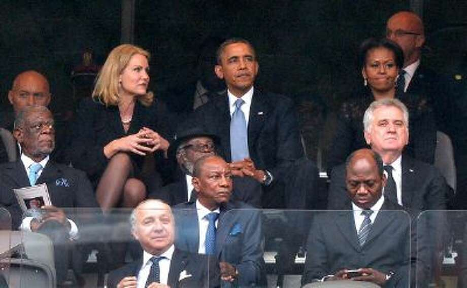 Perhaps Danish Prime Minister Helle Thorning-Schmidt and President Obama shouldn't have sat next to each other for Nelson Mandela's memorial service. Photo: AFP/Getty Images / 2013 AFP