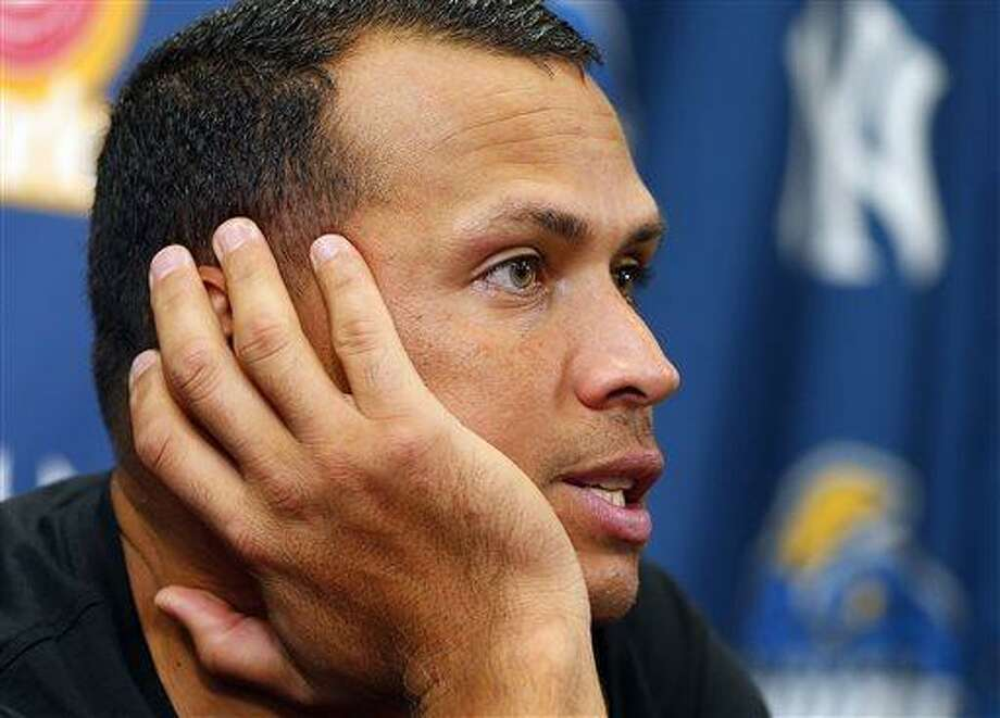 New York Yankees third baseman Alex Rodriguez answers questions from the media during a press conference after a minor league baseball rehab start with the Trenton Thunder in a game against the Reading Fightin Phils, Saturday, Aug. 3, 2013 at Arm & Hammer Park in Trenton, N.J.. (AP Photo/Rich Schultz) Photo: AP / FR27227 AP