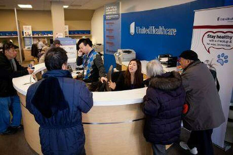 The reception desk at a a UnitedHealthcare store in Queens, New York, on Jan. 14, 2013. The experiment to sell health insurance to consumers in retail stores by UnitedHealth Group Inc., the biggest U.S. medical insurer, is designed to help the company compete in anticipation of sweeping changes under the new health-care law. (Bloomberg News/Michael Nagle)