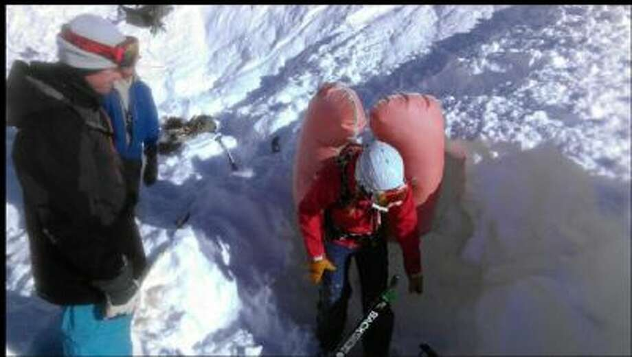 A woman survived being buried in an avalanche near Alta, Colo., Dec. 9. Part of her brush with death was caught on film by her rescuers.