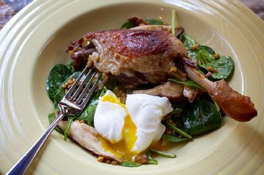 Spinach, Farro and Duck Confit Salad With Poached Egg. Illustrates FOOD-MARKET (category d), by David Hagedorn, special to The Washington Post. Moved Monday, March 3, 2014. (MUST CREDIT: Photo for The Washington Post by Deb Lindsey) Photo: The Washington Post / THE WASHINGTON POST